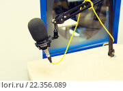 Купить «microphone at recording studio or radio station», фото № 22356089, снято 8 апреля 2015 г. (c) Syda Productions / Фотобанк Лори