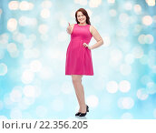 Купить «happy young plus size woman showing thumbs up», фото № 22356205, снято 21 февраля 2016 г. (c) Syda Productions / Фотобанк Лори