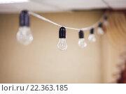 Купить «Гирлянда электрических ламп», фото № 22363185, снято 11 марта 2016 г. (c) Евгений Майнагашев / Фотобанк Лори