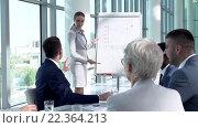 Купить «Young girl at presentation in office», видеоролик № 22364213, снято 22 марта 2016 г. (c) Raev Denis / Фотобанк Лори