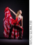 Купить «Young woman dancing in red dress», фото № 22366733, снято 2 марта 2013 г. (c) Elnur / Фотобанк Лори