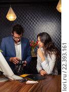 Купить «Creative business people looking at pictures on camera», фото № 22393161, снято 4 октября 2015 г. (c) Wavebreak Media / Фотобанк Лори