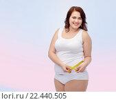 Купить «happy young plus size woman with measuring tape», фото № 22440505, снято 21 февраля 2016 г. (c) Syda Productions / Фотобанк Лори