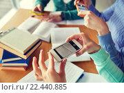 Купить «students with smartphones making cheat sheets», фото № 22440885, снято 6 марта 2015 г. (c) Syda Productions / Фотобанк Лори