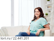 Купить «happy young plus size woman at home», фото № 22441201, снято 21 февраля 2016 г. (c) Syda Productions / Фотобанк Лори