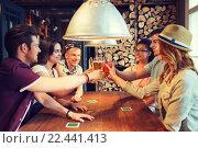 Купить «happy friends drinking beer at bar or pub», фото № 22441413, снято 7 мая 2015 г. (c) Syda Productions / Фотобанк Лори
