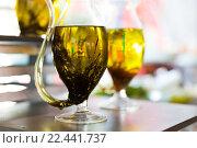 Купить «close up of glass jug with extra vergin olive oil», фото № 22441737, снято 15 февраля 2016 г. (c) Syda Productions / Фотобанк Лори