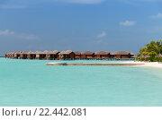 Купить «bungalow huts in sea water on exotic resort beach», фото № 22442081, снято 11 февраля 2016 г. (c) Syda Productions / Фотобанк Лори