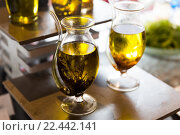 Купить «close up of glass jug with extra vergin olive oil», фото № 22442141, снято 15 февраля 2016 г. (c) Syda Productions / Фотобанк Лори
