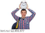 Купить «Student holding alarm clock isolated on white», фото № 22455977, снято 21 апреля 2015 г. (c) Elnur / Фотобанк Лори