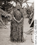 Купить «Woman wearing full mourning costume made of grass, Melanesia, Oceania. After the death of a man his wife was secluded for a certain time. She smeared her...», фото № 22490669, снято 22 октября 2019 г. (c) age Fotostock / Фотобанк Лори