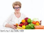 Купить «Женщина держит на столе фруктово овощной набор, белый фон», фото № 22506149, снято 26 марта 2016 г. (c) Кекяляйнен Андрей / Фотобанк Лори