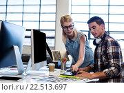 Купить «Graphic designer interacting at their desk», фото № 22513697, снято 30 января 2016 г. (c) Wavebreak Media / Фотобанк Лори