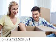Купить «smiling couple with big boxes moving to new home», фото № 22528381, снято 25 февраля 2016 г. (c) Syda Productions / Фотобанк Лори