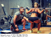 Купить «man and woman with barbell flexing muscles in gym», фото № 22528513, снято 19 апреля 2015 г. (c) Syda Productions / Фотобанк Лори