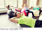 Купить «happy people flexing abdominal muscles on fitball», фото № 22528773, снято 5 апреля 2015 г. (c) Syda Productions / Фотобанк Лори