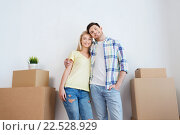 Купить «smiling couple with big boxes moving to new home», фото № 22528929, снято 25 февраля 2016 г. (c) Syda Productions / Фотобанк Лори