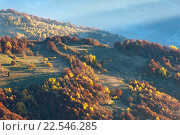 Купить «Sunbeam and autumn misty mountain.», фото № 22546285, снято 4 ноября 2015 г. (c) Юрий Брыкайло / Фотобанк Лори