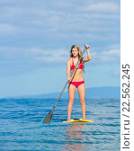 Купить «Young Attractive Woman on Stand Up Paddle Board, SUP, in the Blue Waters off Hawaii, Active Life Concept», фото № 22562245, снято 19 ноября 2018 г. (c) easy Fotostock / Фотобанк Лори