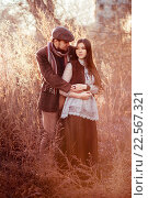 Купить «Стильная пара на закате среди высокой травы», фото № 22567321, снято 2 ноября 2014 г. (c) Евгений Майнагашев / Фотобанк Лори
