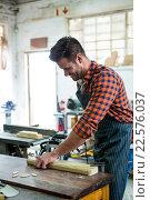 Купить «Carpenter working on his craft», фото № 22576037, снято 14 февраля 2016 г. (c) Wavebreak Media / Фотобанк Лори