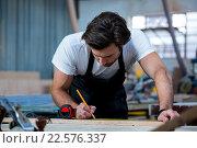 Купить «Carpenter working on his craft», фото № 22576337, снято 14 февраля 2016 г. (c) Wavebreak Media / Фотобанк Лори