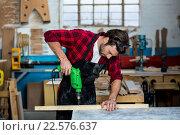 Купить «Carpenter working on his craft», фото № 22576637, снято 14 февраля 2016 г. (c) Wavebreak Media / Фотобанк Лори