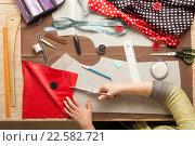 Купить «Table of skilled tailors working», фото № 22582721, снято 24 марта 2016 г. (c) Владимир Мельников / Фотобанк Лори