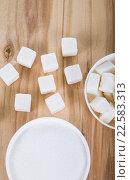 Купить «Sugar in a white bowl», фото № 22583313, снято 9 апреля 2016 г. (c) Елена Блохина / Фотобанк Лори