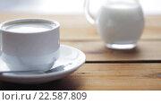 Купить «full cup of coffee on wooden table», видеоролик № 22587809, снято 2 апреля 2016 г. (c) Syda Productions / Фотобанк Лори