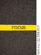 Купить «Road marking yellow line with word FOCUS», фото № 22598017, снято 15 июня 2019 г. (c) PantherMedia / Фотобанк Лори