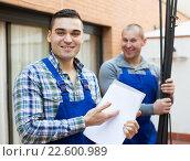 Купить «Two workers at factory», фото № 22600989, снято 5 июля 2020 г. (c) Яков Филимонов / Фотобанк Лори
