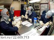 Купить «TIMOR SEA (July 7, 2015) Sailors review damage control information in a repair locker aboard the Nimitz-class aircraft carrier USS George Washington (CVN...», фото № 22609713, снято 7 июля 2015 г. (c) age Fotostock / Фотобанк Лори