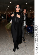 Купить «Selena Gomez lands at Heathrow Airport on a flight from New York, with a male companion. She is in town to perform on 'Children In Need' Featuring: Selena...», фото № 22620833, снято 12 ноября 2015 г. (c) age Fotostock / Фотобанк Лори