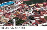 Купить «Остров Roque de Garachico в океане и крыши домов в Гарачико. Север Тенерифе, Канарские острова, Испания», видеоролик № 22647453, снято 19 апреля 2016 г. (c) Кекяляйнен Андрей / Фотобанк Лори
