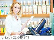 Купить «pharmacist chemist woman working at the cash register», фото № 22649841, снято 15 июля 2015 г. (c) Дмитрий Калиновский / Фотобанк Лори