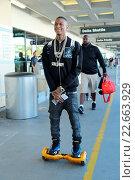 Купить «Rapper, Souljah Boy departs on a flight from Los Angeles International Airport (LAX) riding on a hoverboard Featuring: Souljah Boy Where: Los Angeles,...», фото № 22663929, снято 25 ноября 2015 г. (c) age Fotostock / Фотобанк Лори