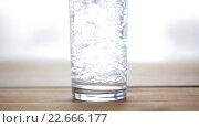 Купить «water pouring into glass on wooden table», видеоролик № 22666177, снято 2 апреля 2016 г. (c) Syda Productions / Фотобанк Лори