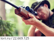 Купить «soldier or hunter shooting with gun in forest», фото № 22669125, снято 14 августа 2014 г. (c) Syda Productions / Фотобанк Лори