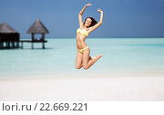 Купить «happy young woman jumping over exotic beach», фото № 22669221, снято 11 июля 2013 г. (c) Syda Productions / Фотобанк Лори