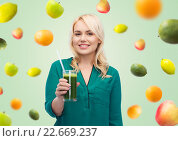 Купить «smiling woman drinking vegetable juice or smoothie», фото № 22669237, снято 7 февраля 2016 г. (c) Syda Productions / Фотобанк Лори