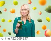 Купить «smiling woman drinking vegetable juice or smoothie», фото № 22669237, снято 7 февраля 2016 г. (c) Syda Productions / Фотобанк Лори