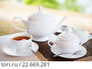 Купить «close up of tea service at restaurant or teahouse», фото № 22669281, снято 16 февраля 2016 г. (c) Syda Productions / Фотобанк Лори
