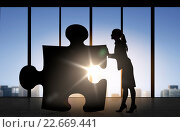 Купить «silhouette of woman mowing puzzle over office», фото № 22669441, снято 22 января 2019 г. (c) Syda Productions / Фотобанк Лори