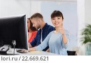 Купить «happy creative team or students working at office», фото № 22669621, снято 27 февраля 2016 г. (c) Syda Productions / Фотобанк Лори