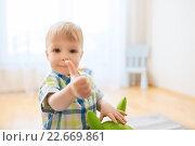 Купить «happy baby boy playing with toy showing thumbs up», фото № 22669861, снято 19 марта 2016 г. (c) Syda Productions / Фотобанк Лори