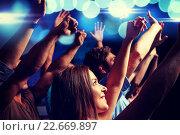 Купить «smiling friends at concert in club», фото № 22669897, снято 20 октября 2014 г. (c) Syda Productions / Фотобанк Лори