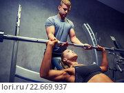 Купить «man and woman with barbell flexing muscles in gym», фото № 22669937, снято 19 апреля 2015 г. (c) Syda Productions / Фотобанк Лори