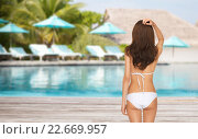 Купить «woman in bikini swimsuit from back over beach», фото № 22669957, снято 12 мая 2013 г. (c) Syda Productions / Фотобанк Лори