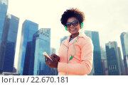 Купить «happy young woman with smartphone and headphones», фото № 22670181, снято 19 марта 2015 г. (c) Syda Productions / Фотобанк Лори
